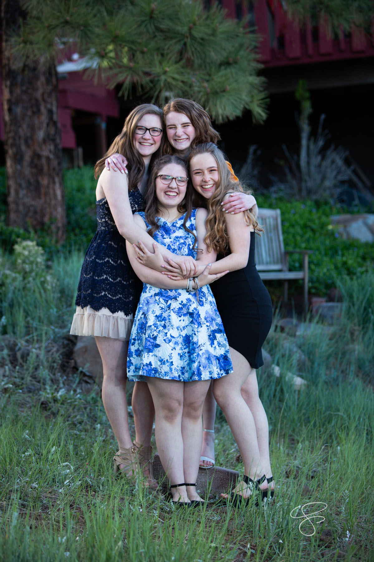 Close friends from multiple high schools in Flagstaff convene for prom photos as they head to the 2019 FALA Prom at Viola's Flower Garden on May 26, 2019. Photo by Sean Openshaw / www.SeanOpenshaw.com